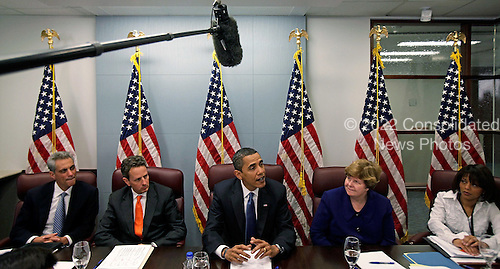 Washington, DC - January 5, 2008 -- United States President-elect Barack Obama (C) answers questions from the press after a meeting with his top economic advisors at the transition headquarters January 5, 2009 in Washington, DC.  The Obama family moved to the capital over the weekend so the daughters could begin school in Washington today. Obama met with Pelosi and will meet with his top economic advisors to begin work on a stimulus package that they hope will include hundreds of billions of dollars worth of tax breaks for individuals and businesses. .Credit: Chip Somodevilla - Pool via CNP