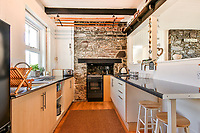 BNPS.co.uk (01202 558833)<br /> Pic: March&Petit/BNPS<br /> <br /> Pictured: The home has a kitchen-diner, with original features including stonework and ceiling beams.<br /> <br /> A charming clifftop cottage which offers breathtaking views of the English channel has emerged on the market for £450,000.<br /> <br /> Mildmay Cottage, in the fishing village of North Hallsands, Devon, backs on to the scenic South West Coastal Path.<br /> <br /> The front door of the three bedroom early 20th century former fisherman's property is just 4ft from the cliff edge.<br /> <br /> It looks out over Start Bay with its historic early 19th century lighthouse and the spectacular Dartmouth headland.<br /> <br /> The home is for sale with estate agent Marchard Petit who say the area is celebrated for its numerous unspoilt coves and beaches.