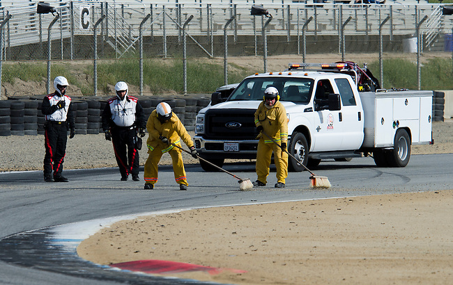 Monterey California, May 4, 2014, Laguna Seca Monterey Grand Prix, track support crew cleans racing surface after incident.