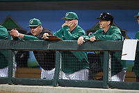 Charlotte 49ers head coach Loren Hibbs (center) watches the action from the dugout during the game against the Clemson Tigers at BB&T BallPark on March 26, 2019 in Charlotte, North Carolina. The Tigers defeated the 49ers 8-5. (Brian Westerholt/Four Seam Images)