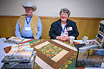 Duane and Dixie McGarva show their new book, The Long Walk during the Friday symposium at STW XXXI, Winnemucca, Nevada, April 12, 2019.<br /> .<br /> .<br /> .<br /> .<br /> @shootingthewest, @winnemuccanevada, #ShootingTheWest, @winnemuccaconventioncenter, #WinnemuccaNevada, #STWXXXI, #NevadaPhotographyExperience, #WCVA