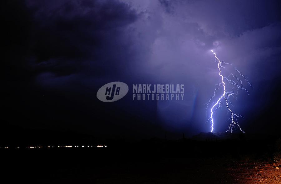 Desert clouds sky thunderstorm lightning bolt storm chaser chasing weather monsoon storm Arizona thunderstorm nature night