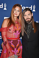 BEVERLY HILLS, CA - APRIL 12: Model/singer/songwriter Jennifer Akerman (L) and actor Tom Payne attend the 29th Annual GLAAD Media Awards at The Beverly Hilton Hotel on April 12, 2018 in Beverly Hills, California.<br /> CAP/ROT/TM<br /> &copy;TM/ROT/Capital Pictures
