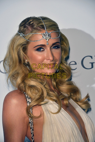 Paris Hilton. 'De Grisogono' party arrivals at the Eden Roc, Hotel du Cap, Antibes during the 66th  Cannes Film Festival, France 21st May 2013.headshot portrait plunging neckline cleavage  silver headband diamonds earrings white     .CAP/PL.©Phil Loftus/Capital Pictures.
