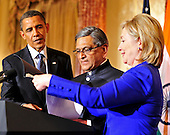 United States Secretary of State Hillary Rodham Clinton, right helps Foreign Minister S.M. Krishna of India, center, with his notes during a reception in the Minister's honor at  at the State Department  in Washington, D.C. on Thursday, June 3, 2010.  U.S. President Barack Obama looks on from the left..Credit: Ron Sachs - Pool via CNP