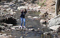 NWA Democrat-Gazette/J.T. WAMPLER Abigail Grubbs, 10, plays in Skull Creek at Wilson Park Sunday March 17, 2019 in Fayetteville. She was at the park with her brother, sister and mother Amanda Bennett of Greenwood.