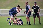 Debutant Tawera Kerr-Barlow passes. Watching is Akira Ioane (L) and Joe Moody. Maori All Blacks Train. Suva, Fiji. July 9 2015. Photo: Marc Weakley