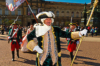 A procession of the Royal Court of August the Strong (people in historical costume) in Theaterplatz, Dresden, Saxony, Germany