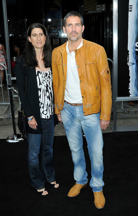Jim Caviezel and wife Kerri Brawitt arriving at the Los Angeles premiere of Super 8, held at the Regency Village Theater, June 8, 2011. Fitzroy Barrett