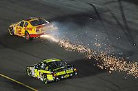 Apr 20, 2007; Avondale, AZ, USA; Nascar Busch Series driver Casey Mears (24) drives below the sparking car of Ryan Newman (12) during the Bashas Supermarkets 200 at Phoenix International Raceway. Mandatory Credit: Mark J. Rebilas