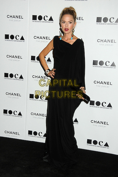 "RACHEL ZOE .attending MOCA's Annual Gala, ""The Artist's Museum Happening"", Sponsored by Chanel Fine Jewelry, held at MOCA Grand Avenue (Museum Of Contemporary Art) in Los Angeles, California, USA, November 13th 2010. .full length long maxi one sleeve dress   black hand on hip clutch bag bracelets .CAP/ADM/BP.©Byron Purvis/AdMedia/Capital Pictures."