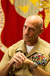 October 21, 2014. Camp LeJeune, North Carolina.<br />  Colonel Matthew St. Clair, seen in his office, is the commanding officer of the Ground Combat Element Integrated Task Force.<br />  The Ground Combat Element Integrated Task Force is a battalion level unit created in an effort to assess Marines in a series of physical and medical tests to establish baseline standards as the Corps analyze the best way to possibly integrate female Marines into combat arms occupational specialities, such as infantry personnel, for which they were previously not eligible. The unit will be comprised of approx. 650 Marines in total, with about 400 of those being volunteers, both male and female. <br />  Jeremy M. Lange for the Wall Street Journal<br /> COED
