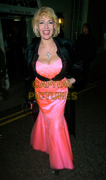FAITH BROWN.Sharon Osbourne's Christmas Party, 30 Pavillion Road, London, UK..December 19th, 2006.full length black coat cardigan pink satin dress cleavage tongue.CAP/CAN.©Can Nguyen/Capital Pictures