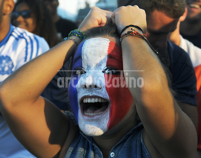A France supporter reacts at the FIFA Fan Fest area on Copacabana beach in Rio de Janeiro, Brazil, during their team's World Cup soccer between France and Honduras, Rio de Janeiro, Brazil, June 15, 2014<br /> <br /> <br /> An Argentina supporter poses on Copacabana beach before the group F World Cup soccer match between Argentina and Bosnia, Rio de Janeiro, Brazil, June 15, 2014