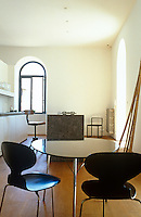 In the kitchen-diner the dining table is situated at one end of a long marble kitchen island