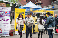 Pay-O-Matic check cashing and money transfer service joins other companies in promoting their services and products to Indian-Americans at the Deepavali street fair in New York on Sunday, October 2, 2016.  (© Richard B. Levine)