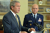 Washington, D.C. - May 8, 2006 -- United States President George W. Bush names Air Force General Michael Hayden to be the next Central Intelligence Agency (CIA) Director in the Oval Office of the White House on May 8, 2006. Hayden will replace Porter Goss if confirmed.     <br /> Credit: Roger Wollenberg - Pool via CNP