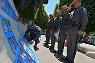 May 12, 2013  (Washington, DC) New York State Police Troopers pay tribute to a fallen officer whose name is etched in the wall of the National Law Enforcement Officers Memorial in D.C.    (Photo by Don Baxter/Media Images International)
