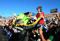 Nov 14, 2010; Pomona, CA, USA; NHRA funny car driver John Force celebrates with the fans after clinching the 2010 funny car championship during the Auto Club Finals at Auto Club Raceway at Pomona. Mandatory Credit: Mark J. Rebilas-