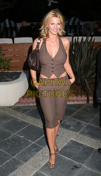 NATASHA HENSTRIDGE.Travel + Leisure Magazine's 35th Birthday Party at W Hotel, Westwood, California, USA..April 19th, 2006.Photo: Byron Purvis/AdMedia/Capital Pictures.Ref: BP/ADM.full length cropped brown trousers vest top pinstripe halterneck.www.capitalpictures.com.sales@capitalpictures.com.© Capital Pictures.