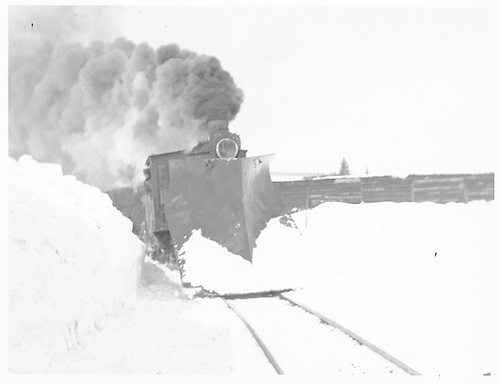 Unidentified engine with large wedge pilot plow and a helper near the Cumbres wye snowshed.<br /> D&amp;RGW  Cumbres, CO