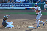 Las Vegas 51s' Jordany Valdespin turns a double play against Reno Aces' Tyler Bortnick during a Triple-A baseball game in Reno, Nev., on Sunday, July 21, 2013. The 51s won 15-8.<br /> Photo by Cathleen Allison