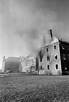 Smoke billows from the ecole nationale de police du Quebec in Nicolet near Montreal, on March 27, 1973.<br /> <br /> 20 % of the building, a former seminary was damaged by the fire<br /> <br /> Photo : Agence Quebec Presse  -  Alain Renaud