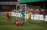 Visiting defender Kyle Rowley heading his team into the lead as Ilkeston Town (in red) host Walsall Wood in a Midland Football League premier division match at the New Manor Ground, Ilkeston. The home team were formed in 2017 taking the place of Ilkeston FC which had been wound up earlier that year. Watched by a crowd of 1587, their highest of the season, the match was top versus second, however, the visitors won 4-0 and replaced their hosts at the top of the division on goal difference with two matches to play
