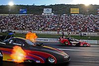 Jul, 22, 2011; Morrison, CO, USA: NHRA funny car driver Todd Simpson  (left) alongside Jeff Diehl during qualifying for the Mile High Nationals at Bandimere Speedway. Mandatory Credit: Mark J. Rebilas-