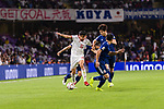 Mahdi Torabi of Iran (L) fights for the ball with Haraguchi Genki of Japan (R) during the AFC Asian Cup UAE 2019 Semi Finals match between I.R. Iran (IRN) and Japan (JPN) at Hazza Bin Zayed Stadium  on 28 January 2019 in Al Alin, United Arab Emirates. Photo by Marcio Rodrigo Machado / Power Sport Images