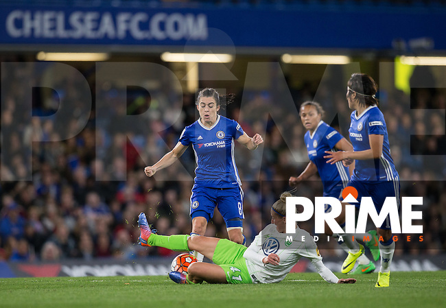 Anja Mittag of VfL Wolfsburg (women) slides in on Karen Carney of Chelsea Ladies during the UEFA Women's Champions League match between Chelsea Ladies and VfL Wolfsburg at Stamford Bridge, London, England on 5 October 2016. Photo by Andy Rowland.