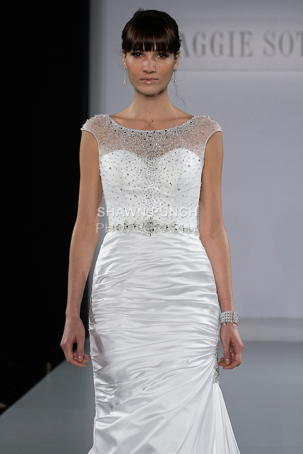 Model walks runway in a Tia wedding gown from the Maggie Sottero Spring 2013 collection, at The Couture Show, during New York Bridal Fashion Week, on October 14, 2012.