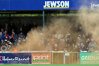 A smoke bomb from Woking fans interrupts play during Woking vs Dagenham & Redbridge, Vanarama National League Football at The Laithwaite Community Stadium on 7th October 2017