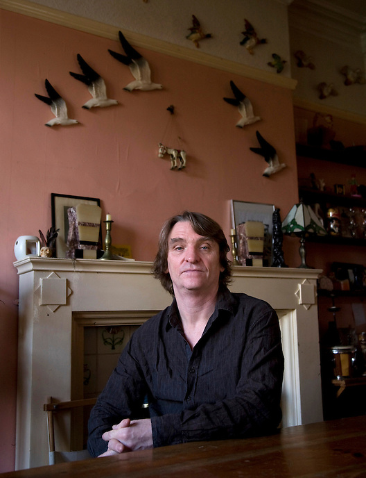 Prize-winning author Melvyn Burgess at his home in Manchester, UK. Burgess is regarded as one of the best writers in contemporary literature. In 1997 his controversial bestseller Junk won the Guardian Children's Fiction Award and the Carnegie Medal. It was also shortlisted for the 1998 Whitbread Children's Book of the Year. Four of his novels have been shortlisted for the Carnegie Medal: The Cry of the Wolf, An Angel for May, The Baby and Fly Pie and The Ghost Behind the Wall.