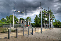 Electrical substation under a dramatic cloudy sky
