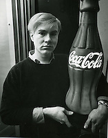 Warhol with a coca cola prop.