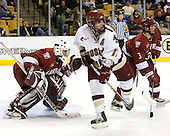 Joe Rooney (Boston College - Canton, MA) skates through Kyle Richter (Harvard University - Calgary, AB) and Alex Biega (Harvard University - Montreal, PQ). The Boston College Eagles defeated the Harvard University Crimson 3-1 in the first round of the 2007 Beanpot Tournament on Monday, February 5, 2007, at the TD Banknorth Garden in Boston, Massachusetts.  The first Beanpot Tournament was played in December 1952 with the scheduling moved to the first two Mondays of February in its sixth year.  The tournament is played between Boston College, Boston University, Harvard University and Northeastern University with the first round matchups alternating each year.