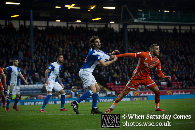 Blackburn Rovers 3 Shrewsbury Town 1, 14/01/2018. Ewood Park, League One. Home captain Charlie Mulgrew has his shirt pulled by Carlton Morris at a set-piece during the first-half as Blackburn Rovers played Shrewsbury Town in a Sky Bet League One fixture at Ewood Park. Both team were in the top three in the division at the start of the game. Blackburn won the match by 3 goals to 1, watched by a crowd of 13,579. Photo by Colin McPherson.