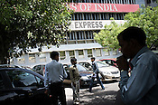 Pedestrians walk past the offices of major Indian newspapers in ITO, New Delhi, India. Photo: Sanjit Das/Panos