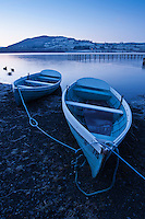 Row boats on shore at Llangorse lake, Llangors, Brecon Beacons national park, Wales
