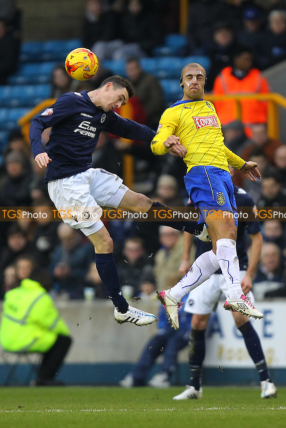 James Vaughan of Huddersfield Town rises with Shaun Williams of Millwall - Millwall vs Huddersfield Town - Sky Bet Championship Football at the New Den, Bermondsey, London  - 07/02/15 - MANDATORY CREDIT: Gavin Ellis/TGSPHOTO - Self billing applies where appropriate - contact@tgsphoto.co.uk - NO UNPAID USE