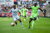 Eliaquim Mangala of Manchester City  takes the ball from Andre Ayew of Swansea City  during the Barclays Premier League match between Swansea City and Manchester City played at the Liberty Stadium, Swansea on the 15th of May  2016