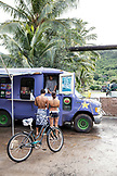 USA, Oahu, Hawaii, portrait of MMA Mixed Martial Arts Ultimate fighter Lowen Tynanes and Logan Garcia buy Acai Bowls at a food truck on the North Shore of Oahu