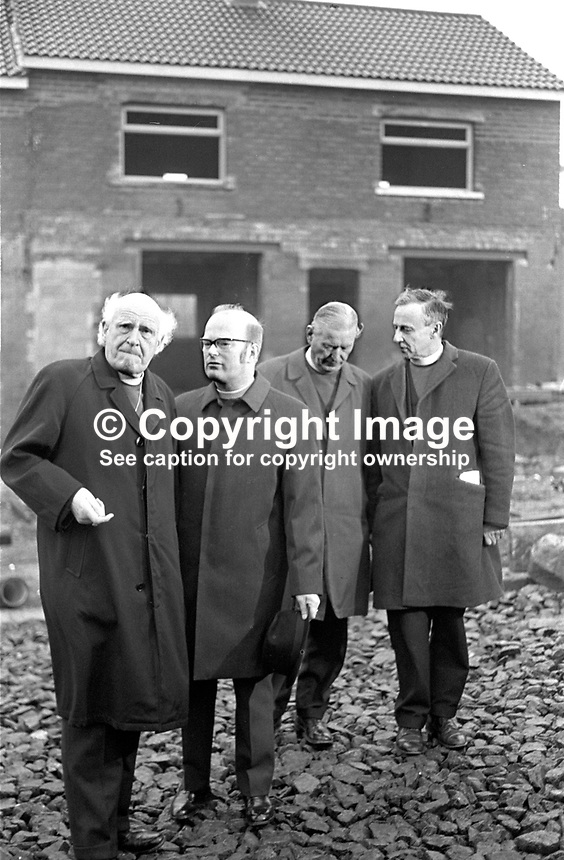Anglican Archbishop of Canterbury, Michael Ramsey, left, during a May 1973 visit to the Ardoyne district of Belfast, N Ireland. He is accompanied by (from left) Rev Noel Wilkinson, the local rector, Rt Rev Arthur Butler, Church of Ireland Bishop of Connor, and Archbishop George Otto Simms, the Church of Ireland Primate.197305030261.<br /> <br /> Copyright Image from Victor Patterson,<br /> 54 Dorchester Park, <br /> Belfast, UK, BT9 6RJ<br /> <br /> t1: +44 28 9066 1296 (from Rep of Ireland 048 9066 1296)<br /> t2: +44 28 9002 2446 (from Rep of Ireland 048 9002 2446)<br /> <br /> m: +44 7802 353836<br /> <br /> e: victorpatterson@me.com<br /> www.victorpatterson.com<br /> <br /> Please see my Terms and Conditions of Use at www.victorpatterson.com. It is IMPORTANT that you familiarise yourself with them.<br /> <br /> Images used on the Internet must be visibly watermarked i.e. &copy; Victor Patterson<br /> within the body of the image and copyright metadata must not be deleted. Images <br /> used on the Internet have a size restriction of 4kbs and will be chargeable at current<br />  NUJ rates unless agreed otherwise.<br /> <br /> This image is only available for the use of the download recipient i.e. television station, newspaper, magazine, book publisher, etc, and must not be passed on to any third <br /> party. It is also downloaded on condition that each and every usage is notified within 7 days to victorpatterson@me.com<br /> <br /> The right of Victor Patterson to be identified as the author is asserted in accordance with The Copyright Designs And Patents Act (1988). All moral rights are asserted.