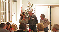 Peggy Bakker and Paul Spongberg look on as xxxx reads the PAPA educational fund raffle prize winner's name (Phil Pieri), Petaluma Area Pilots Association, 2017 Holiday Potluck Party, Petaluma Hotel, Petaluma, California