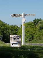 Signpost and handmade sign to local Farmers' Market, Warehorne, Kent.