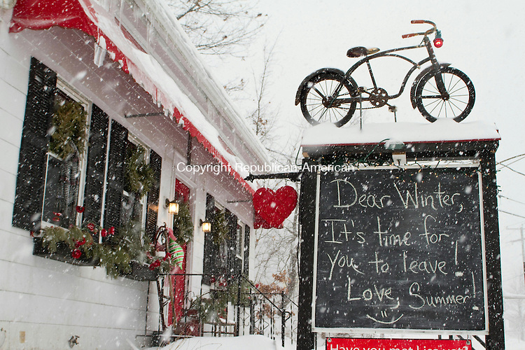 WATERTOWN, CT 13 February 2014-021314LW03 - A sign in front of the Plaid Poppy gift shop on Main Street in Watertown longs after summer as snow flies Thursday afternoon.<br /> Laraine Weschler Republican-American