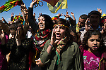 Ahin, center, a 13-year-old Syrian Kurdish refugee from Kobani, sings at Newroz, the Kurdish New Year celebration, in Suruç, Turkey, March 17, 2015. Newroz, or Nowruz, is an ancient holiday celebrated by a multitude of ethnic groups across Iran, Central Asia, and the Caucuses, and ushers in the first day of Spring, March 21. For Kurds, Newroz is a means of political and cultural expression, featuring Kurdish politicians, activists, and musicians, and has become a manifestation of Kurdish identity. In Turkey, the celebrations begin a few days before the Vernal Equinox, culminating in a huge gathering in the heart of Turkey's Kurdish population, the southeastern city of Diyarbakir. This year, PKK founder Abdullah Öcalan, who despite serving a life sentence for treason still enjoys widespread influence among Kurds, sent a letter that was read at Newroz in Diyarbakir, calling for an end to the PKK's armed struggle against the Turkish state.