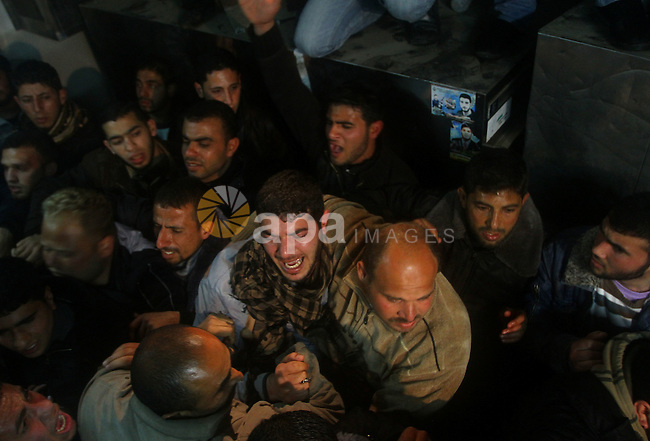 Relatives of a man killed in an Israeli airstrike mourn at a morgue in Gaza City, Friday, March 9, 2012. The Israeli military said in a statement that it targeted two rocket launching positions in the Gaza Strip Friday. Photo by Ashraf Amra