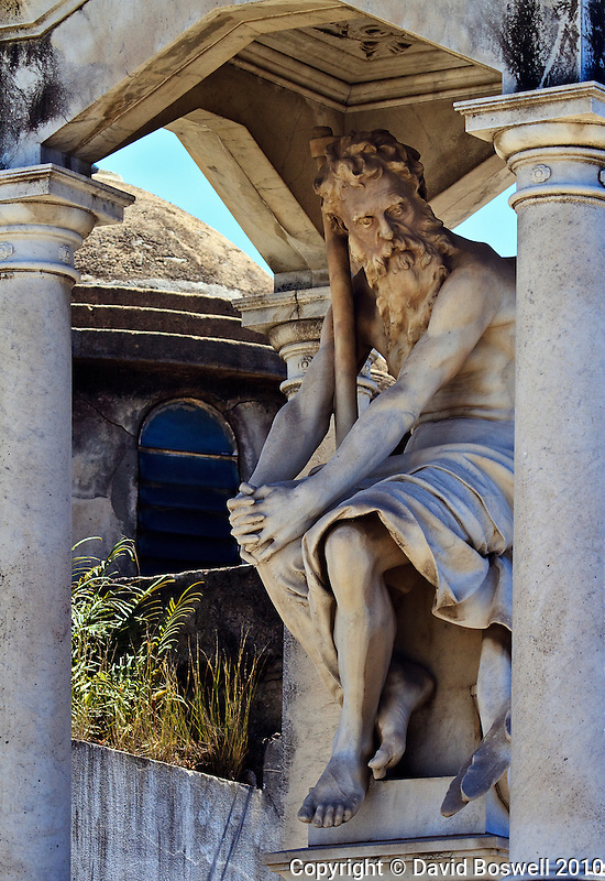 A well preserved sculpture decorates a tomb in the Cementario de la Recoleta in Buenos Aires, Argentina.